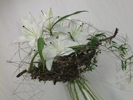 Nestle the lilies and jasmine tendrils in a spring twig nest.jpg