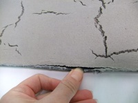 Casting wet cement to have surface cracks