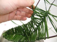 Weaving a pod shape from ripped foliage