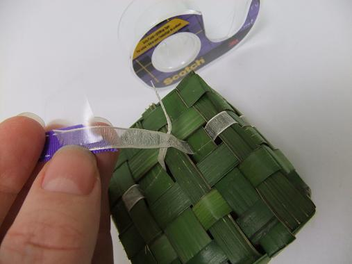 Tape the guide ribbon to you decorative ribbon
