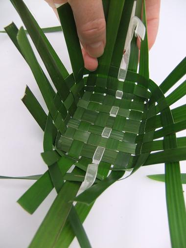Fold up the ribbon and weave it as you do the foliage.