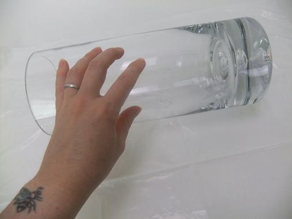 Set a vase on its side on a plastic lined working surface.