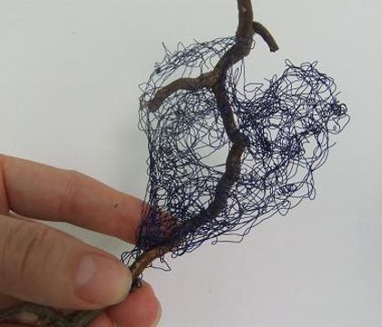 Knotted and tangled wire heart
