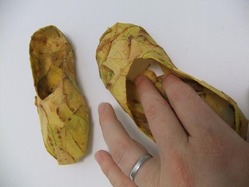 Reach deep into the slipper toe and cover the inside sole