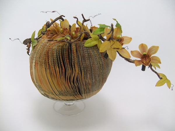 Cymbidium, hazel and passion fruit vines on a paperback book pumpkin