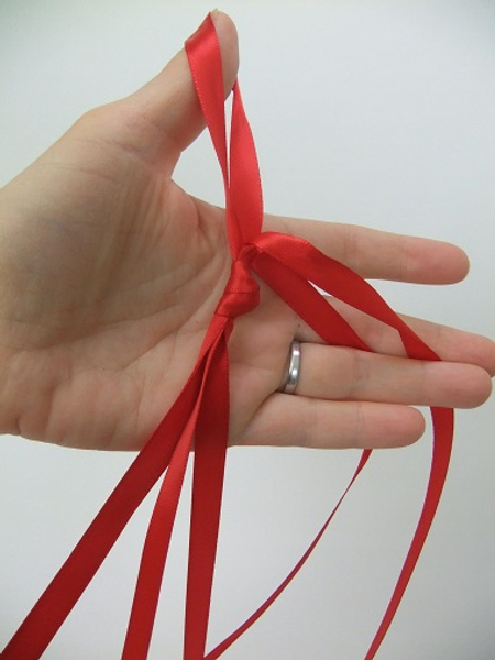 Knot the ribbon at the top to combine