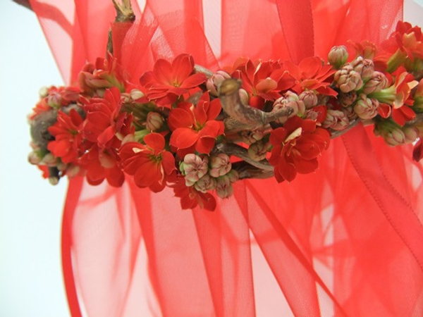 Red Kalanchoe and hazel twig flower girl net basket ready to fill with confetti or petals