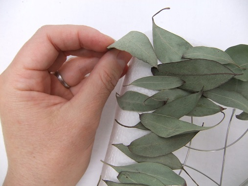 Decorate polystyrene by gluing or pinning plant material to it.