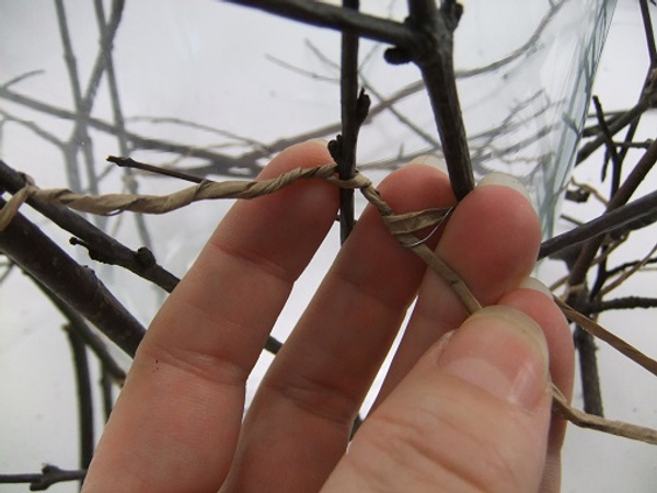 Split the wire open and twist it to secure the next twig