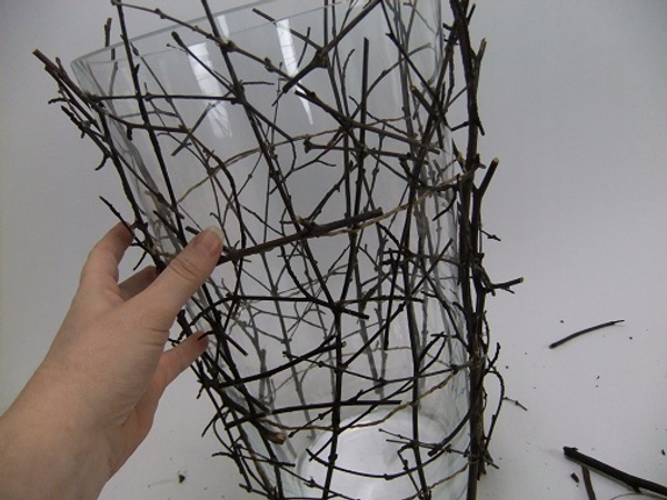Wiggle the twigs to make sure you glue the twigs to other twigs and not to the glass vase