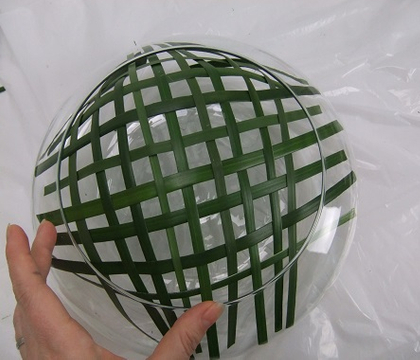 Weave a foliage grid for a shallow container