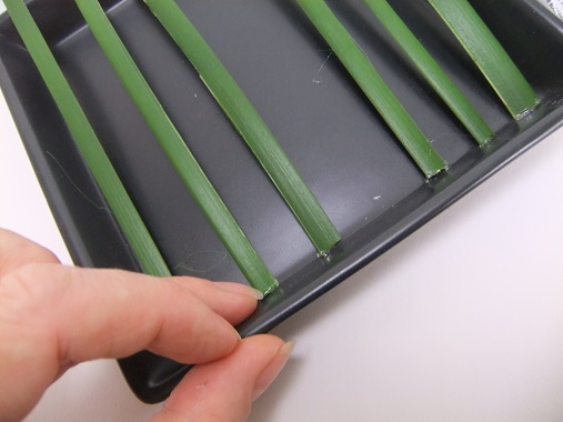 Continue to glue blades of grass leaving a gap to make it easier to work