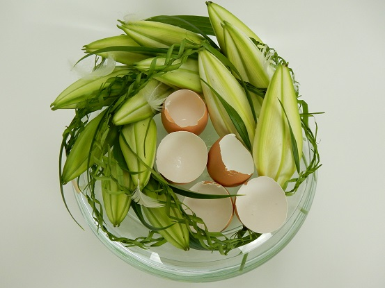 Easter lilies and palm leave garlands.