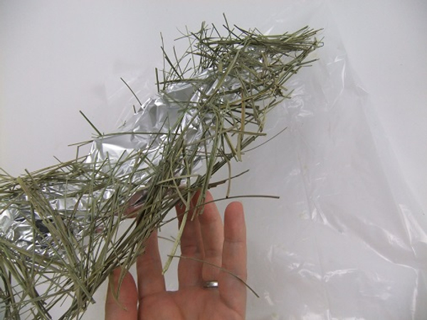 Lift the scattered grass armature from your working surface