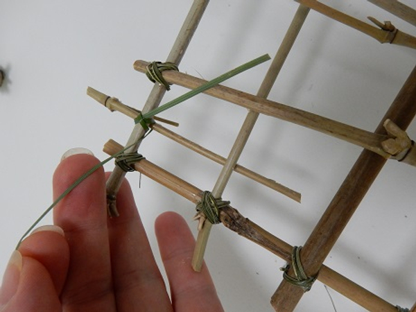 Cut two hooks from bamboo and latch it to the panel