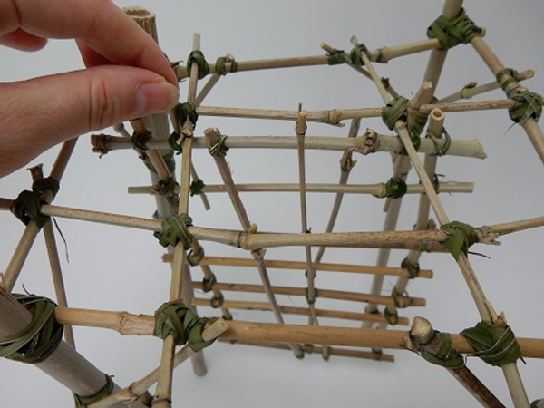Hook the panel into the bamboo scaffolding armature