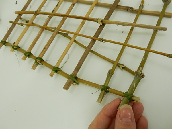 Move down the length of bamboo and latch each piece together