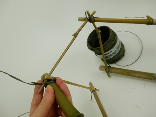 Separate the two sections of bamboo with two thinner pieces and latch