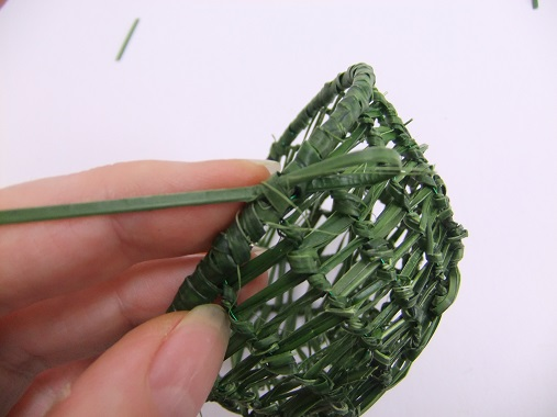 Knot the strand of grass on itself and cut away any loose pieces