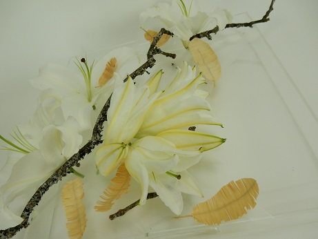 Lilies in a clear tray