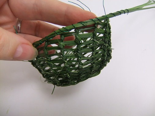 Work your way around the basket securing the strands and the wire