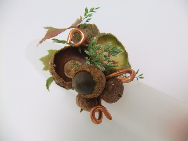 Autumn ring design with copper wire, acorns, grass and fall leaves