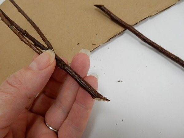 Cut each twig at a very sharp angle so that it easily spears into the polystyrene