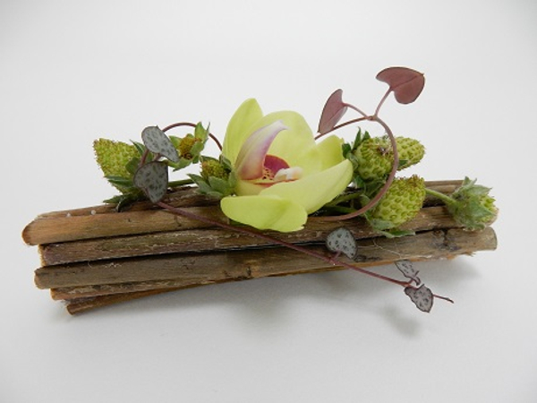A twig corsage using a magnet