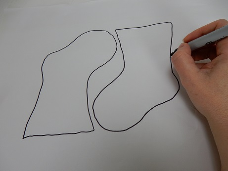Draw a very basic Christmas stocking outline to use as a guiding template