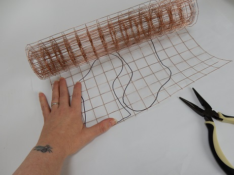 Measure out copper mesh to the size of the template.