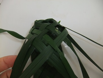 Fold each leaf up and weave through