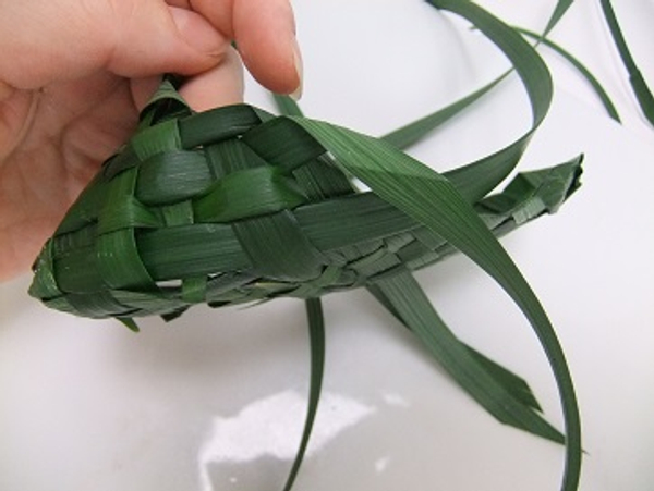 Simply fold over the leaf and weave it