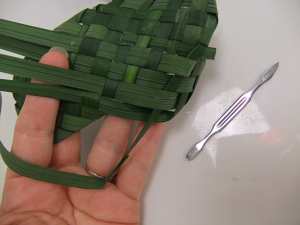 To make it easier to feed the leaves back into the weave use a cuticle pusher as a guide