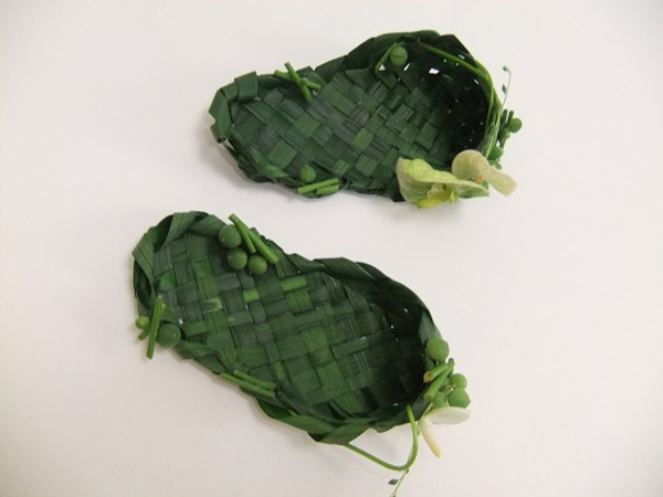Weaving foliage to make slippers