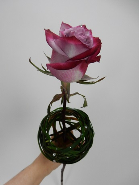 Slip a rose into the hollow to display on a vase