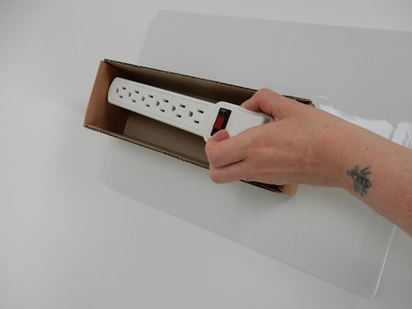 Measure the box by placing the power strip into the box.