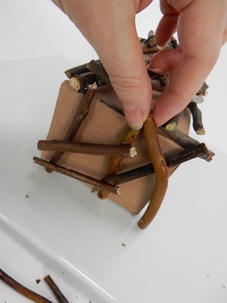 Turn the box and glue twigs to follow the side shape of the box