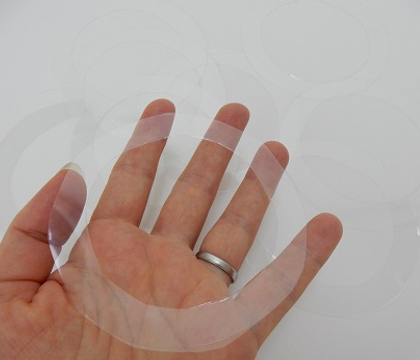 Floating transparent ripples to support delicate floral material