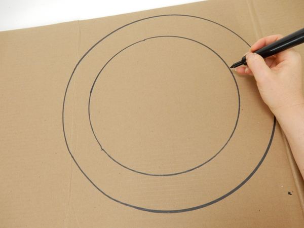 Draw two circles on a sturdy cardboard sheet.