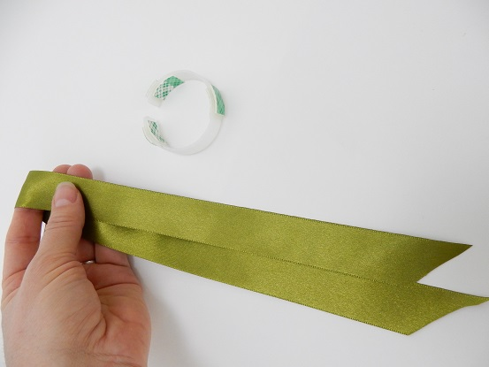 Fold the ribbon in half to get the middle point