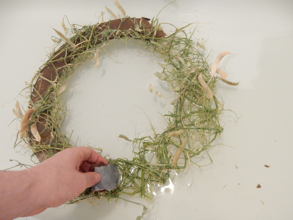 Move around the wreath and rip out the soggy cardboard