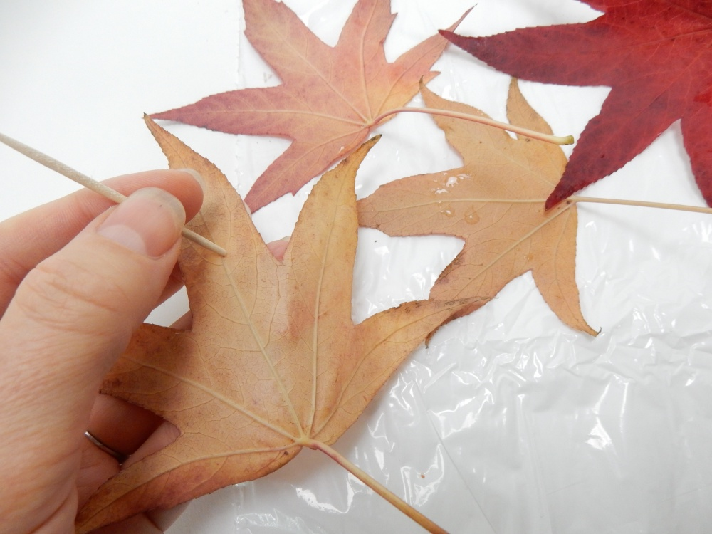 Make a small guide hole in a autumn leaf with a bamboo skewer