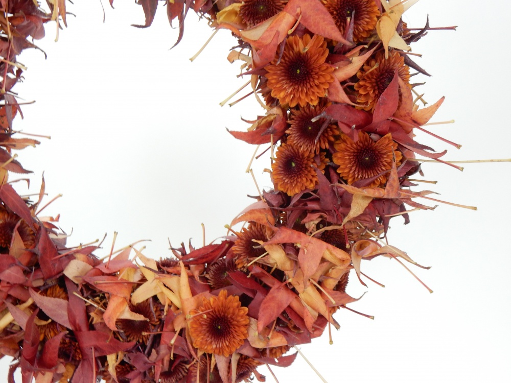 Rolled autumn leaf wreath