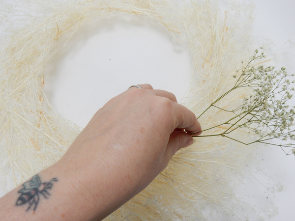 Place the wreath on a flat working surface and glue a snippet of dried Gyp to follow the shape
