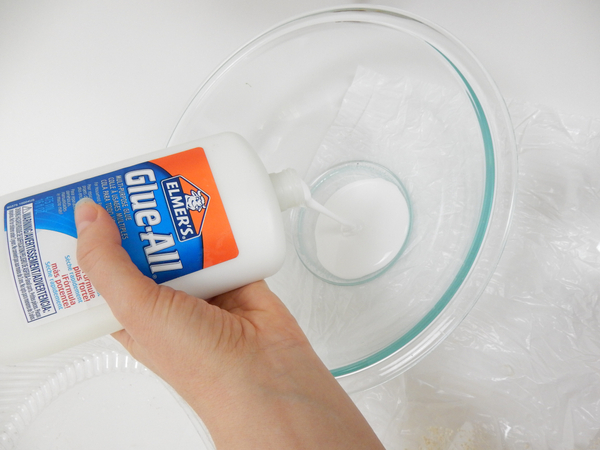Pour wood glue into a deep container