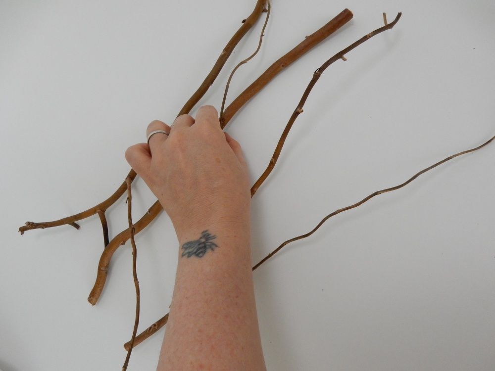 Add another twig and make sure to glue it to three other twigs.