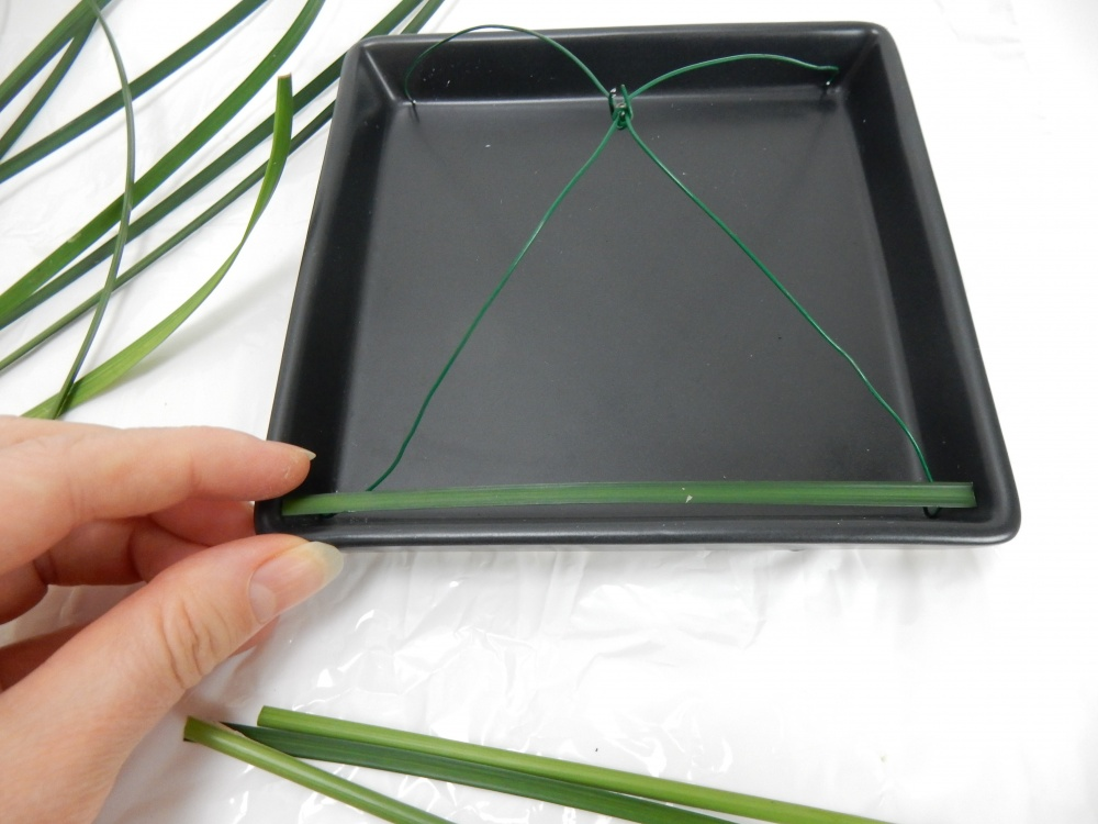 Glue a blade of grass from one end of the wire to the other