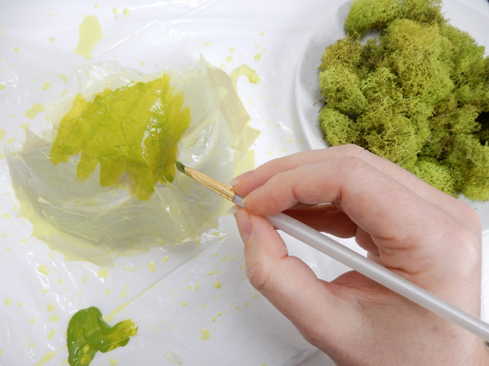 Paint the paper mask moss green