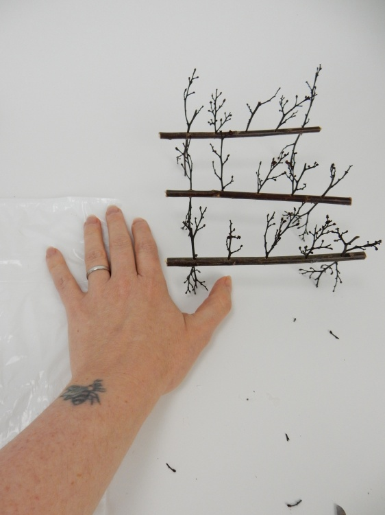 Stand the twig armatures and adjust to make sure it is balanced by snipping away some of the stick ends