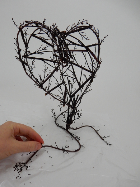 Add a few delicate twigs to the base
